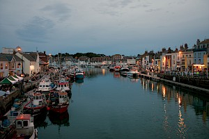 UK – Dorset, Weymouth Harbour during blue hour by Lukes_photos is licensed under CC BY-SA 2.0