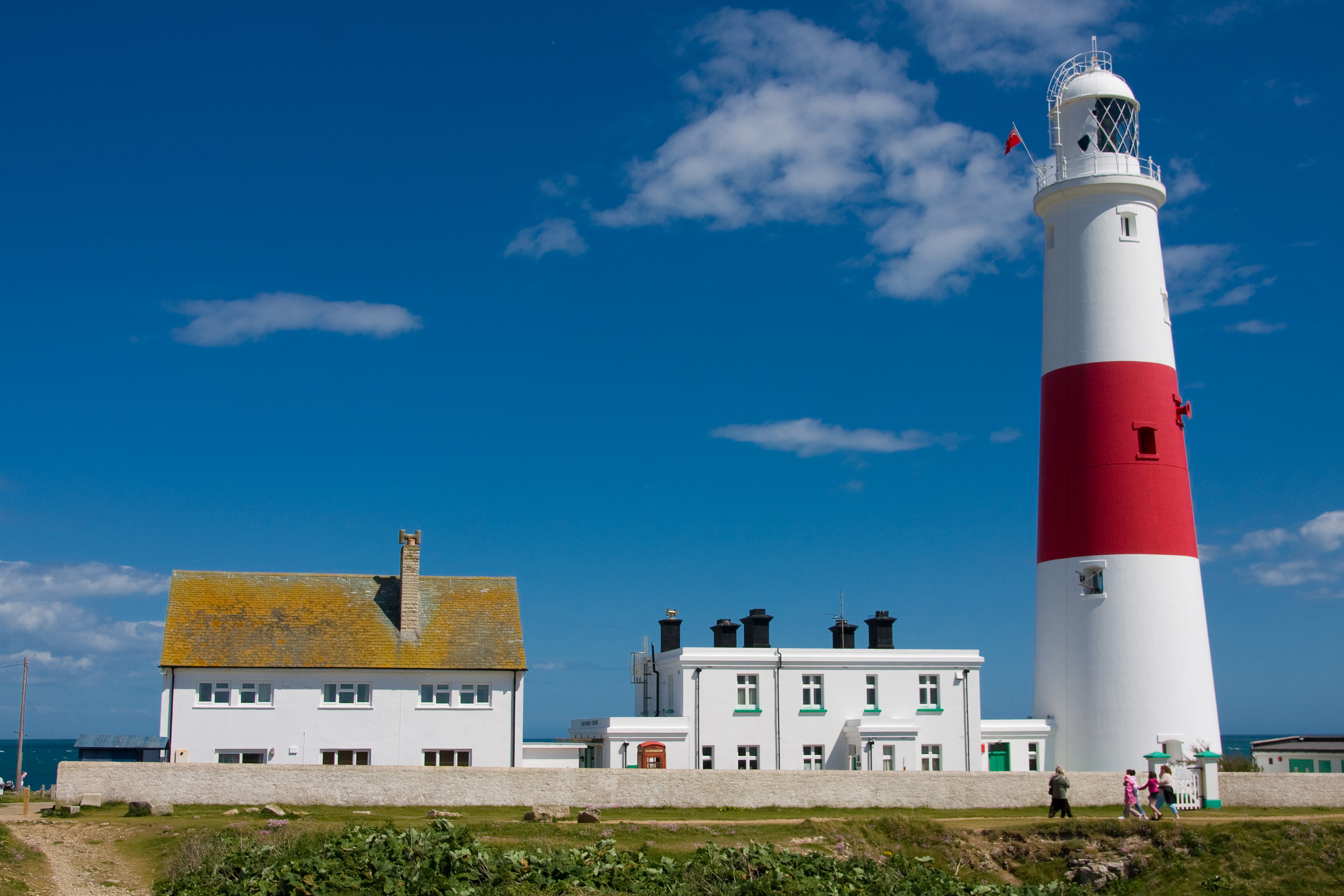 Portland Bill Lighthouse and Buildings by Paul Tomlin licensed under CC BY 2.0